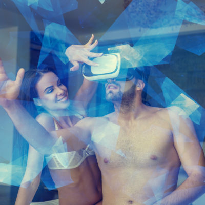 Sensual coupl playing virtual reality glasses at home, blue glowing polygons